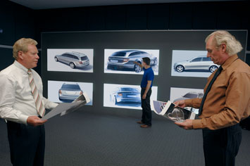 Peter Pfeiffer (left) and Karl-Heinz Bauer (right) discussing the first Mercedes-Benz C-Class Estate design sketches at the powerwall