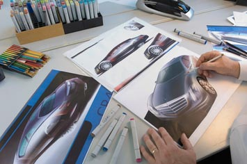 Chris Rhoades sketching the Mercedes-Benz F700 Concept with pencils and Copic markers
