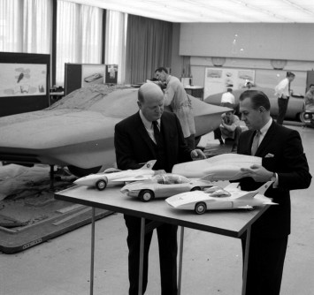 1964 GM Styling Vice President Bill Mitchell examines scale models in the design studio