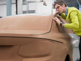 Christopher Weil and a clay model of the 2013 BMW 2 Series Coupe
